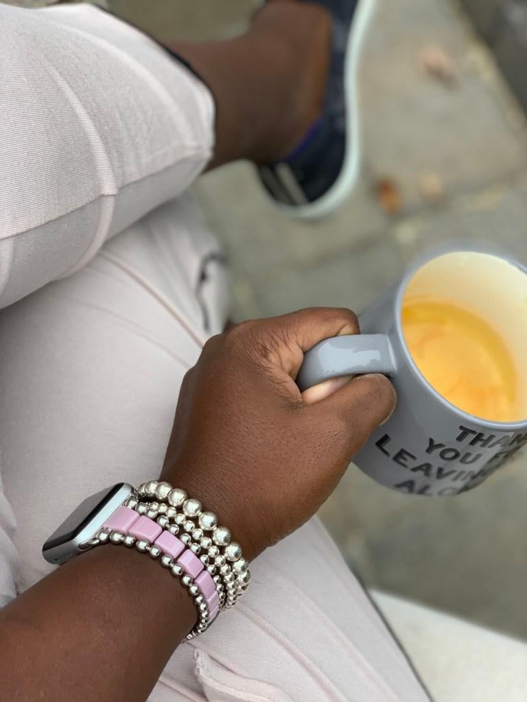 Brow Girl enjoying cup of tea with Lagos jewelry self care in pink