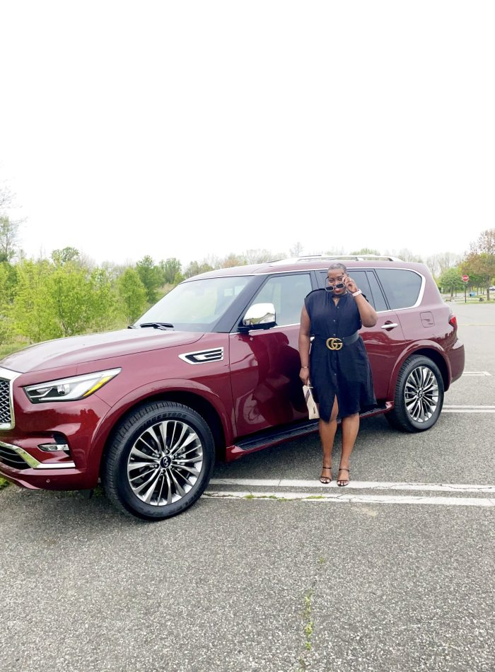 Infiniti QX80 red with brown girl