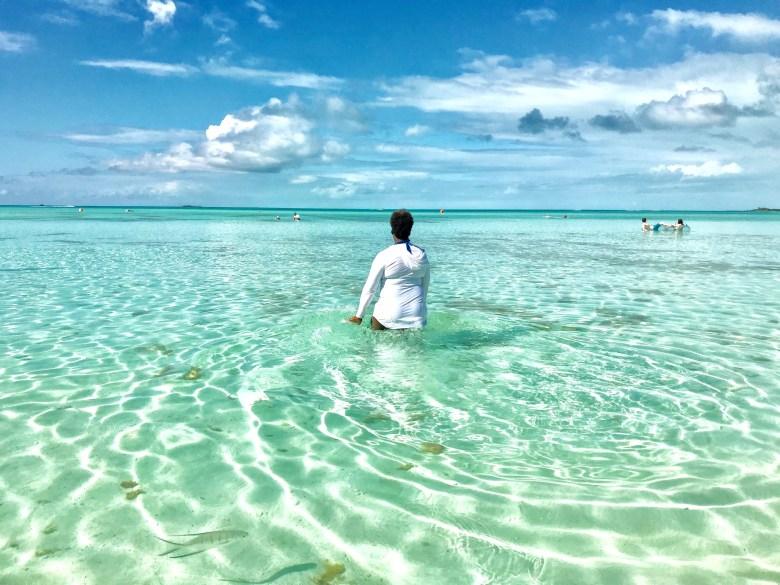 black girl in ocean Bahamas