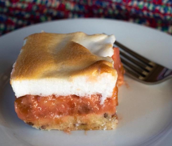 a serving of rhubarb meringue dessert