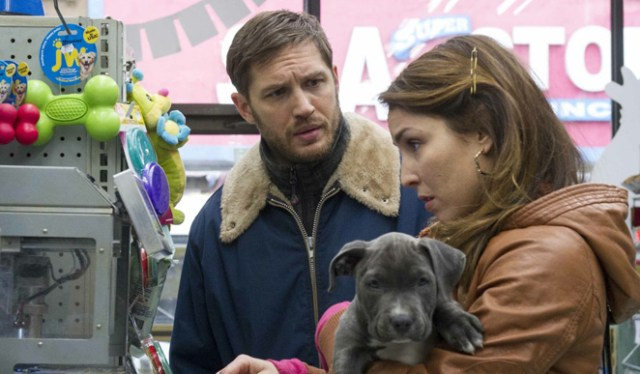 Tom Hardy, Noomi Rapace, and the dog - something is blossoming, and it's not the dog