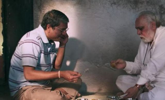 Adil Hussain cant eat while his boss is chewing off his ears. Lalit Behl has no such problems.
