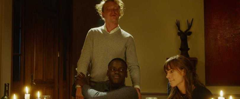 Caleb Landry Jones, Daniel Kaluuya, and Allison Williams have some tense dinner moments.