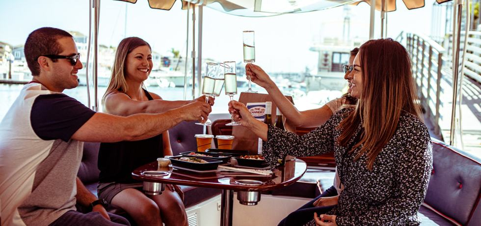 Friends Cheers on a Duffy Boat in Newport Beach