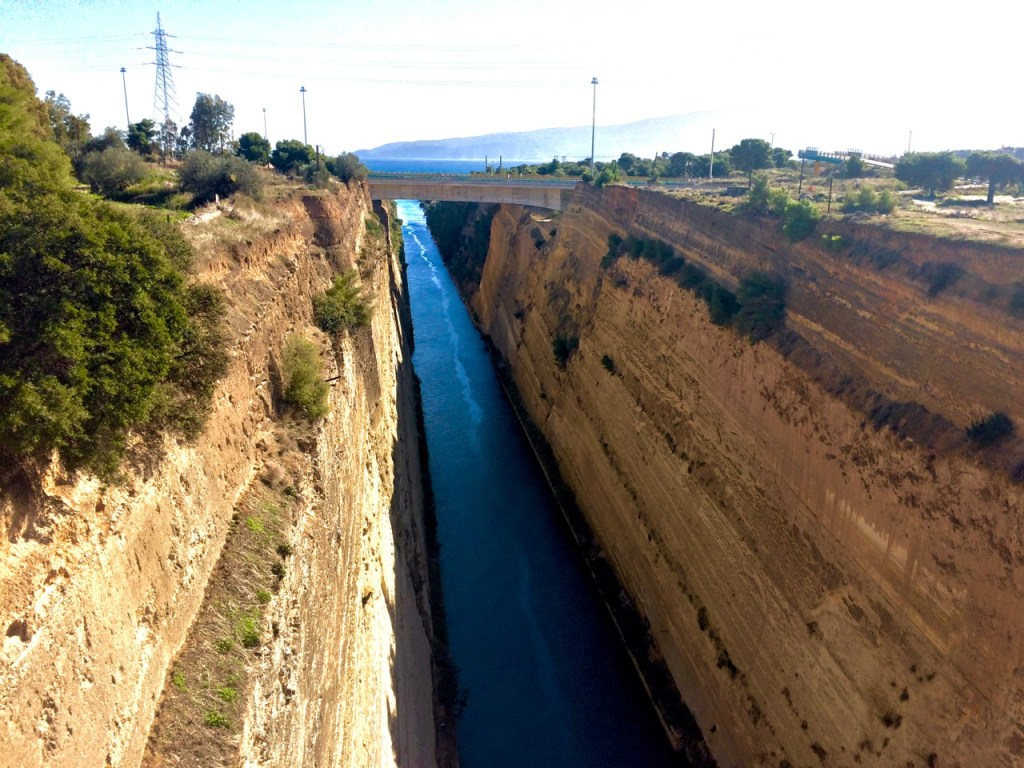 Corinth Canal with sheer sandstone brown walls with a narrow base