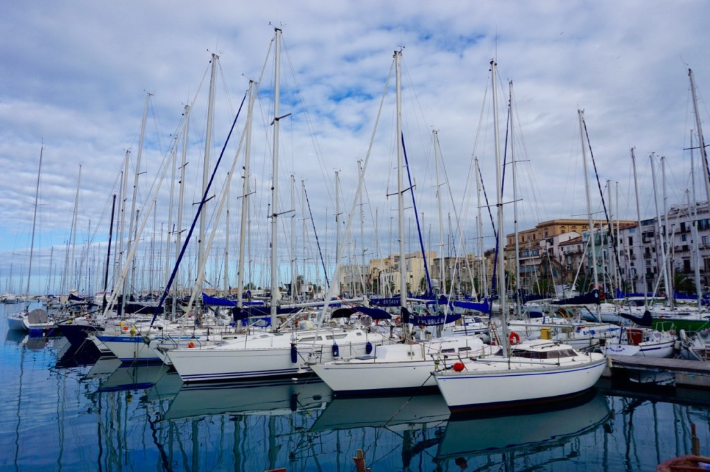 Busy marina with many boats moored side by side