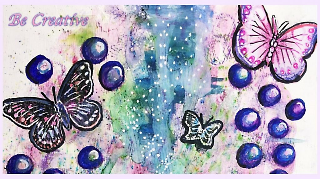 painting of butterflies bubbles and swathes of blues and greens - in the top left corner is the phrase Be creative - encouraging the reader to use their creativity
