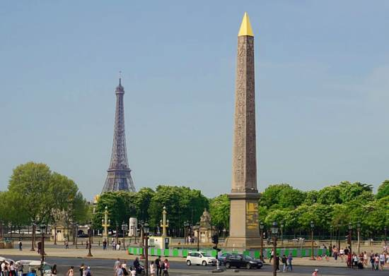 Egyptian obelisk in the square with the Eiffel Tower in the background