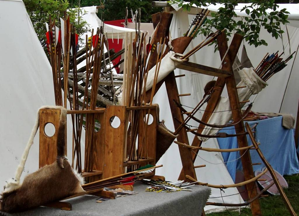 Many wooden arrows and wooden bows on display at the viking festival