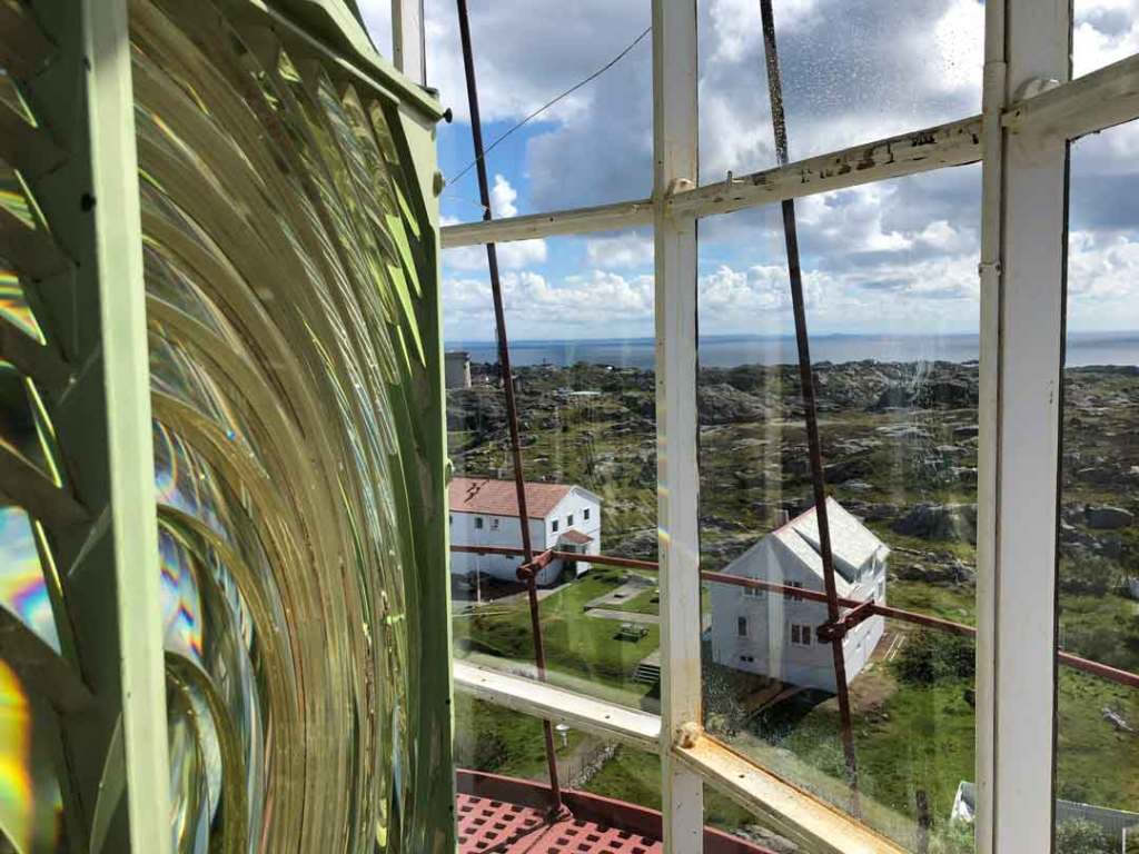 At the top of the light house looking out, on the left of the photo is the lantern and then the buildings below can be seen through the window