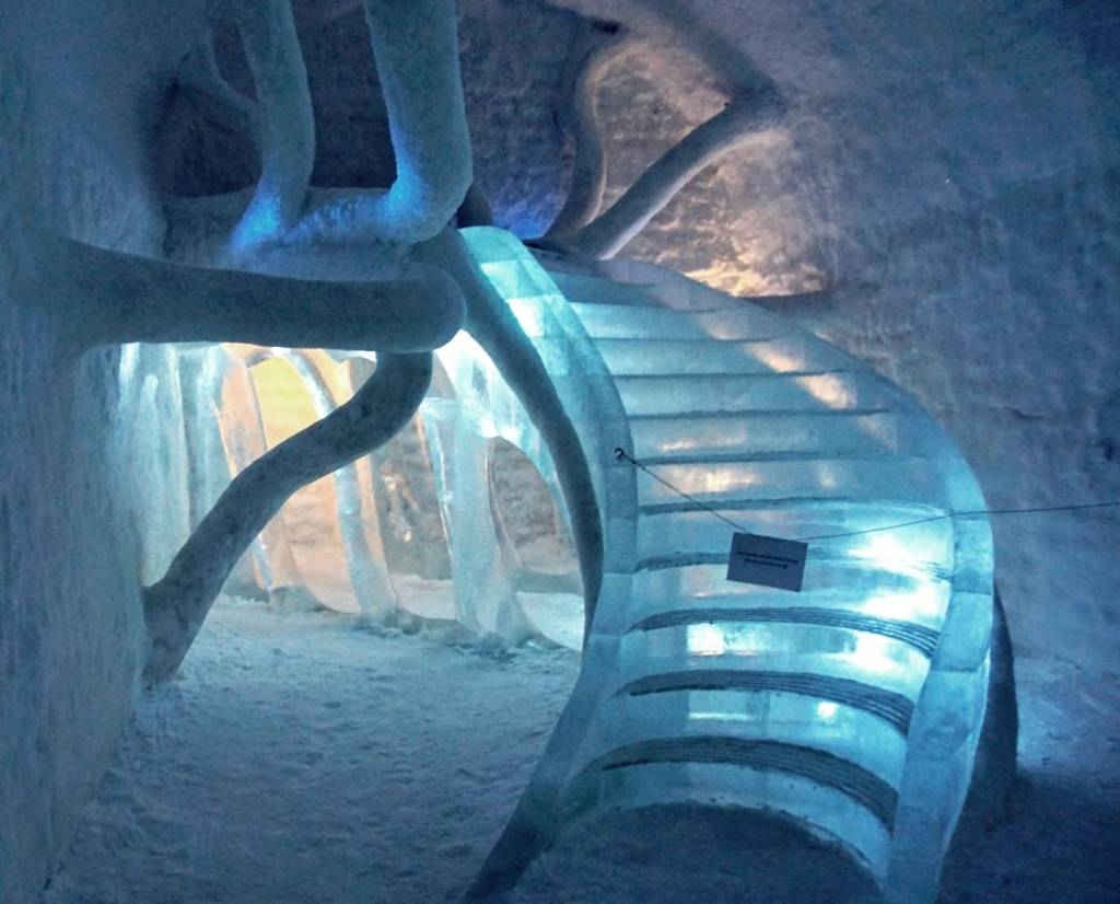 winding staircase made of ice leading up to a bed