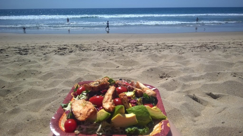 A salad with the Pacific Ocean in the background - a great food option for the perfect picnic.