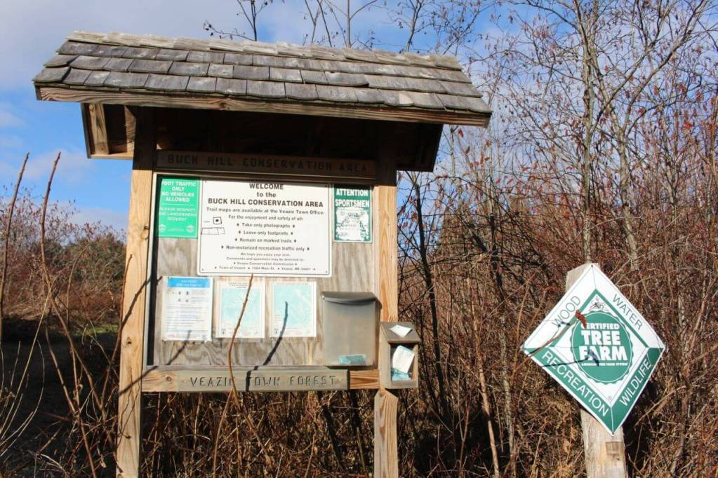 The trail map board in front of Buck Hill Conservation Area in Veazie, Maine.