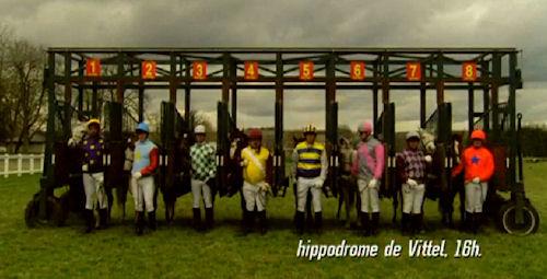 Vittel Water advertisement: Jockeys standing by horses at starting gate