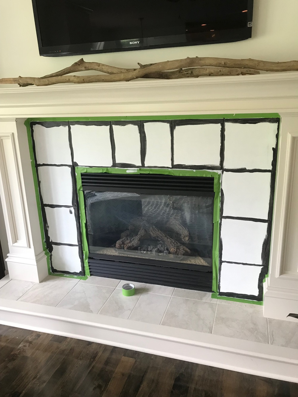 painted tile around fireplace life