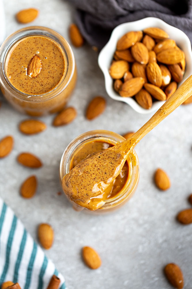 How to make Homemade Almond Butter – Learn how easy it is to make healthy and delicious homemade almond butter using your food processor or high speed Vitamix blender. It comes together quickly and makes a delicious snack alternative to peanut butter.