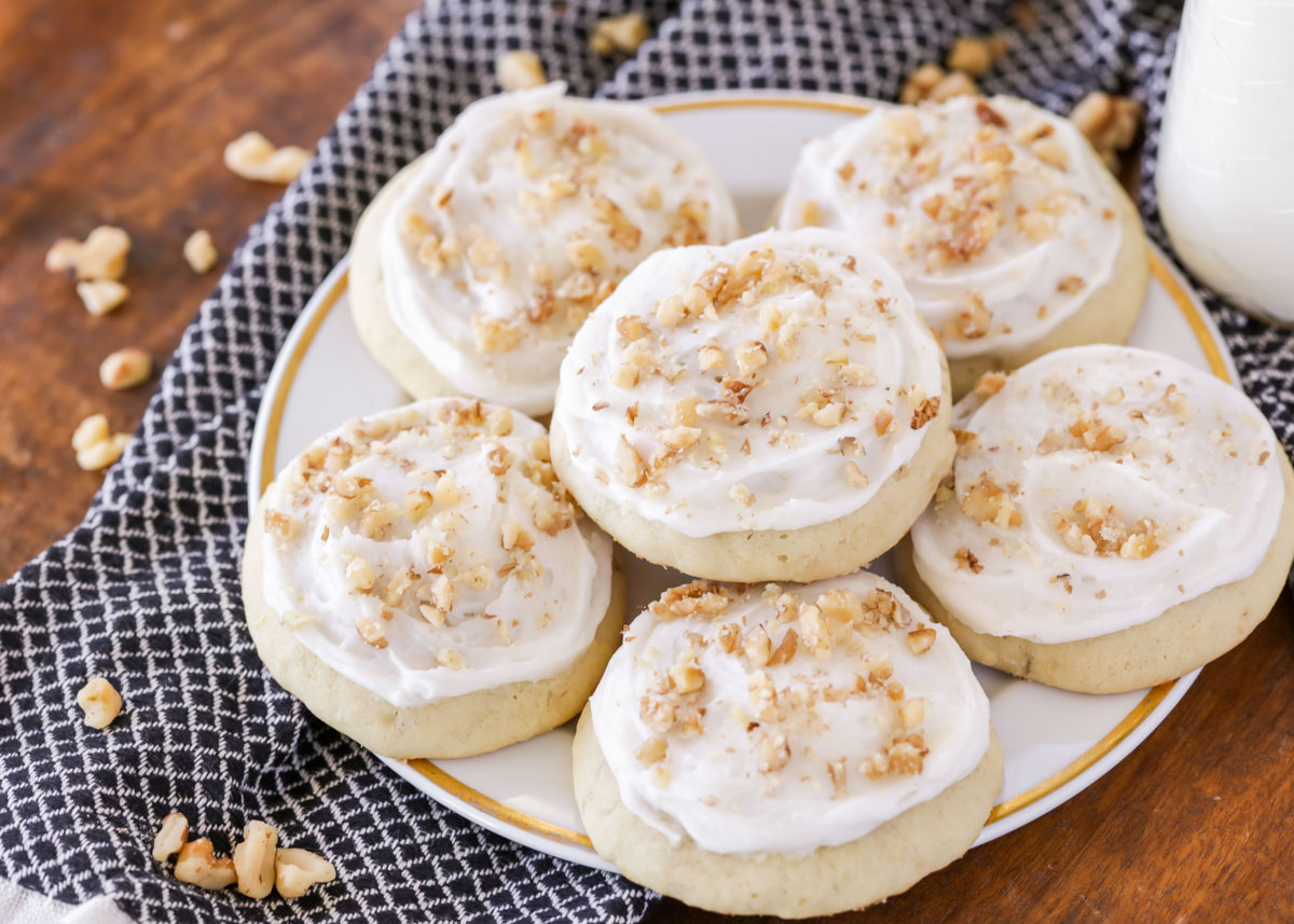 Banana cookies topped with nuts on a plate