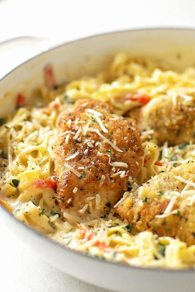 Creamy Tuscan Garlic Chicken in a white serving bowl
