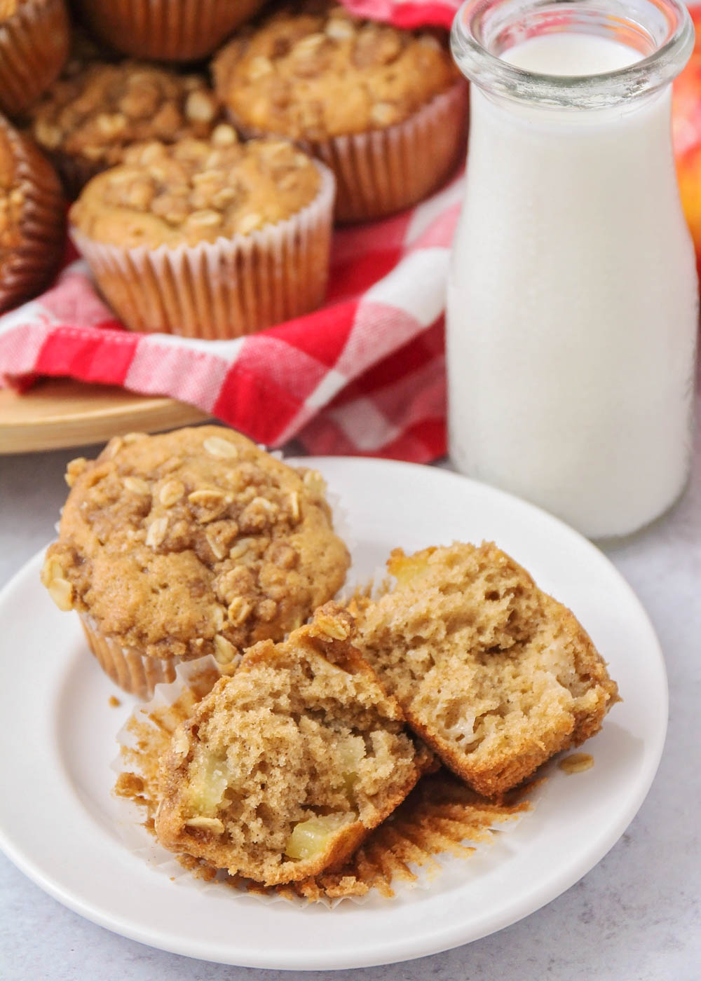 Closeup of apple muffins on a white plate
