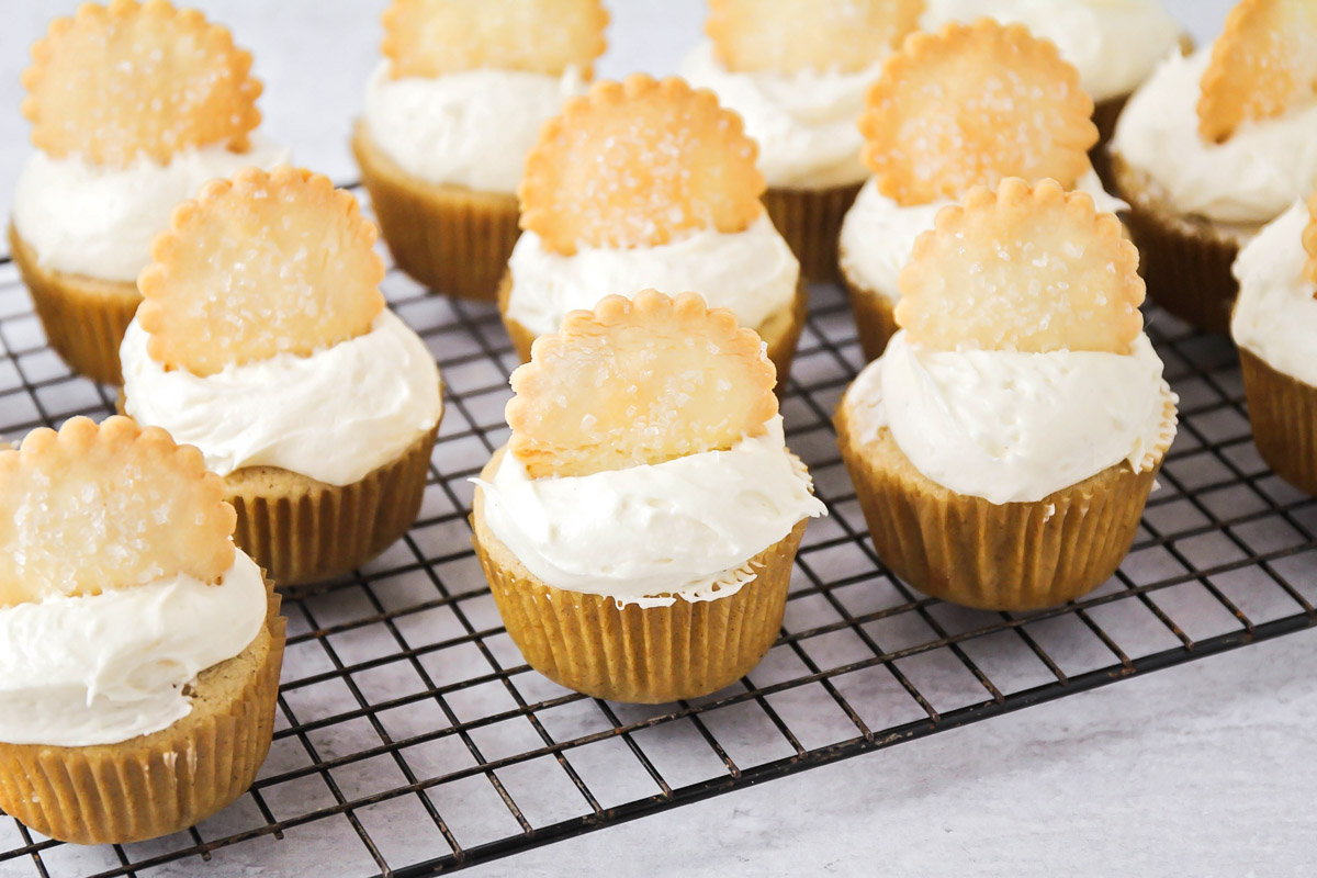 Apple pie cupcakes on a cooling rack