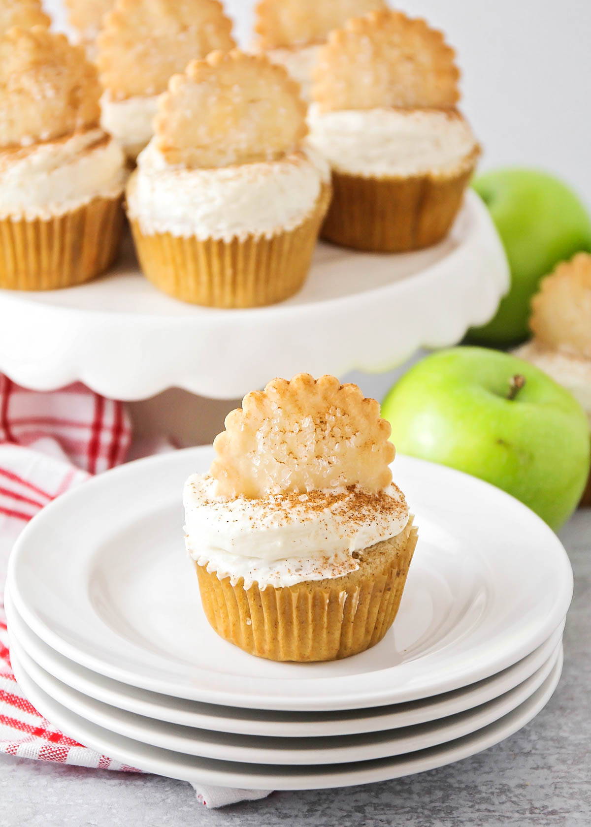 Apple pie cupcake topped with pie crisp, served on a white plate