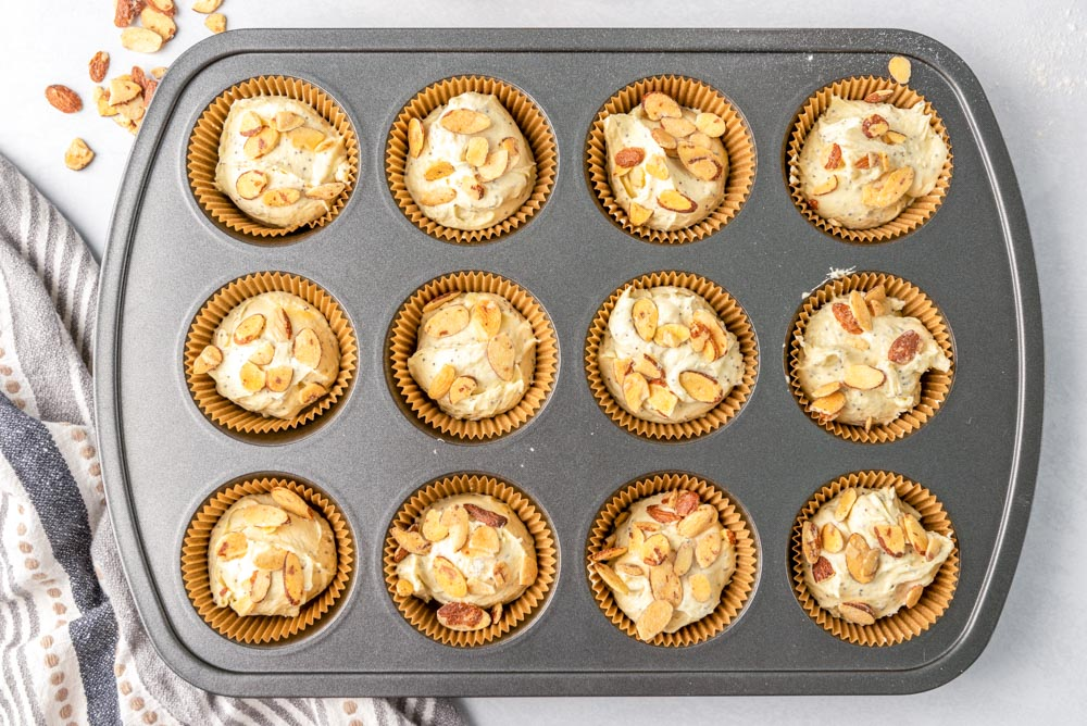 Almond poppy seed muffins with almonds sprinkled on top