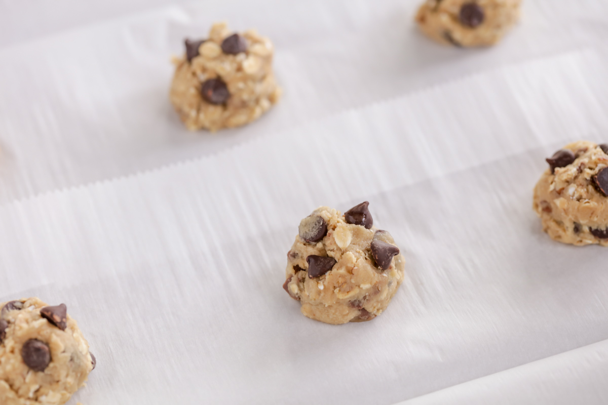 Carmelita cookie dough on a baking sheet with parchment paper