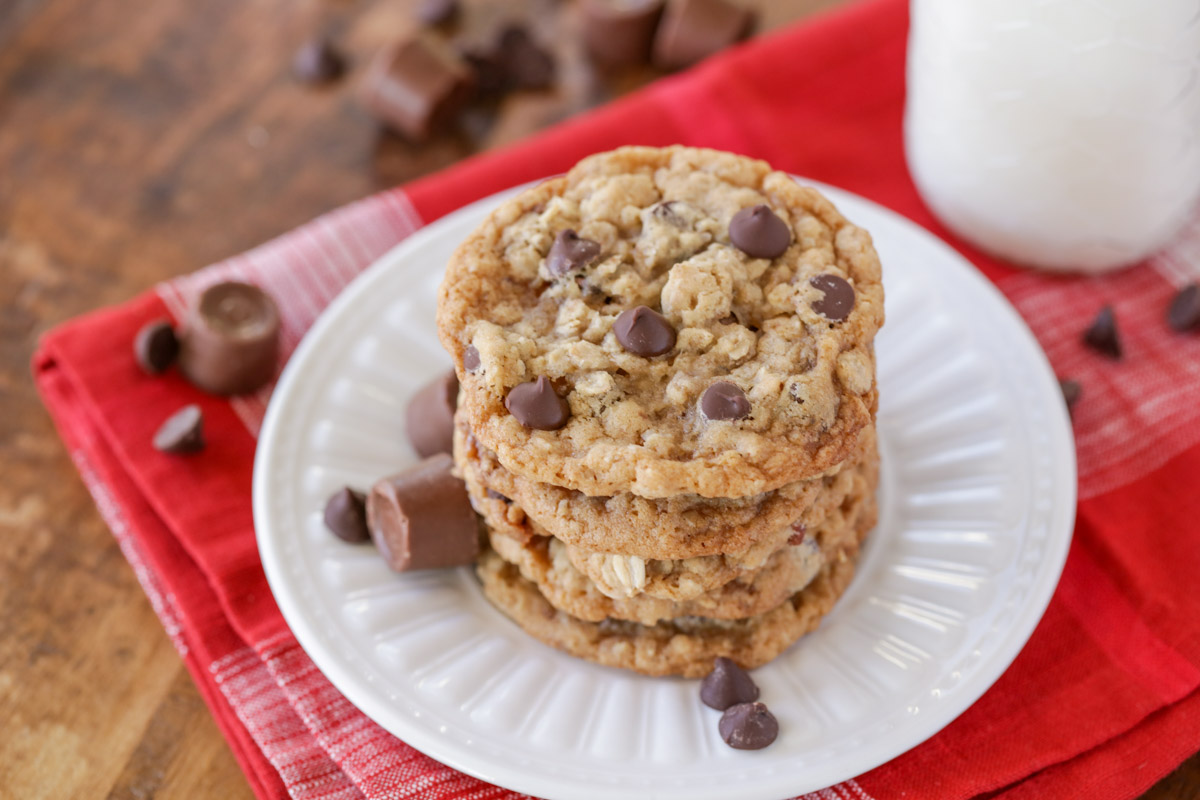 A stack of carmelita cookies on a white plate