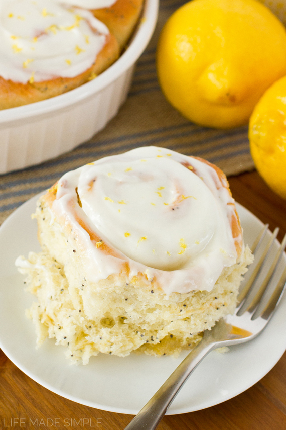 Lemon Poppy Seed Sweet Roll on a plate with a fork