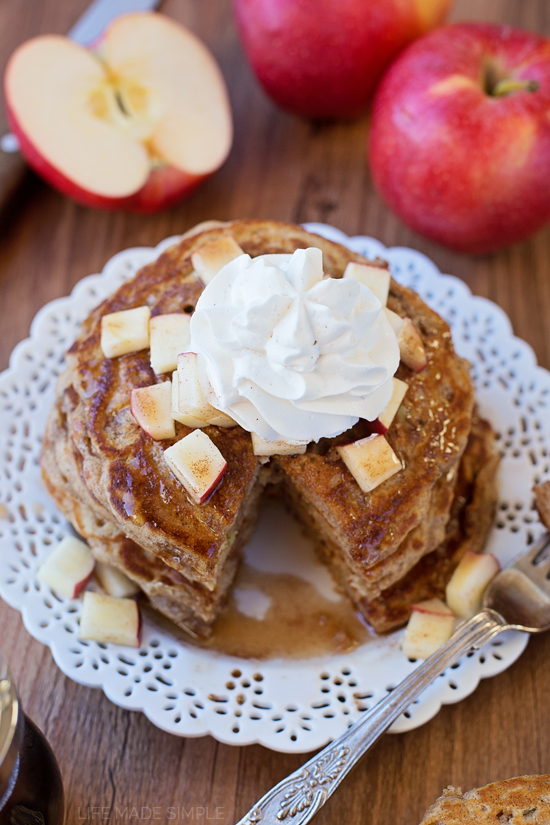 Apple Pie Pancakes with Apple Spice Maple Syrup on a white plate