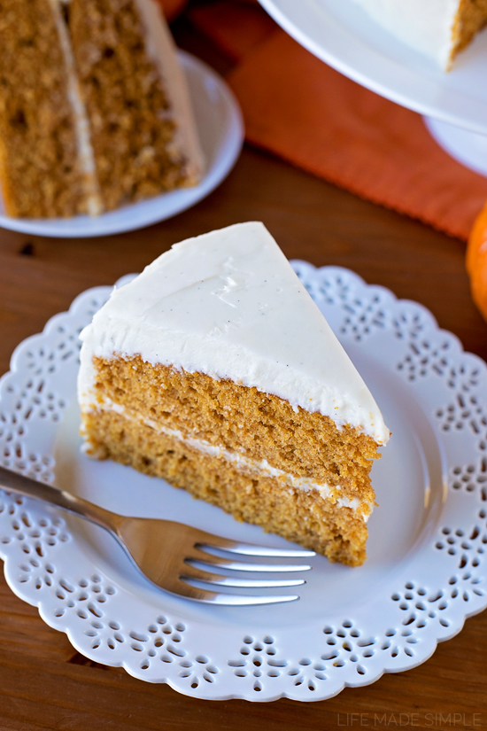 A slice of Pumpkin Layer Cake with Maple Vanilla Bean Frosting