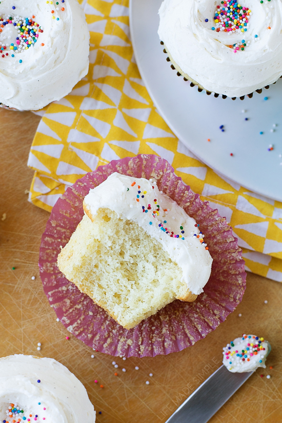 Classic vanilla cupcakes with frosting and rainbow sprinkles