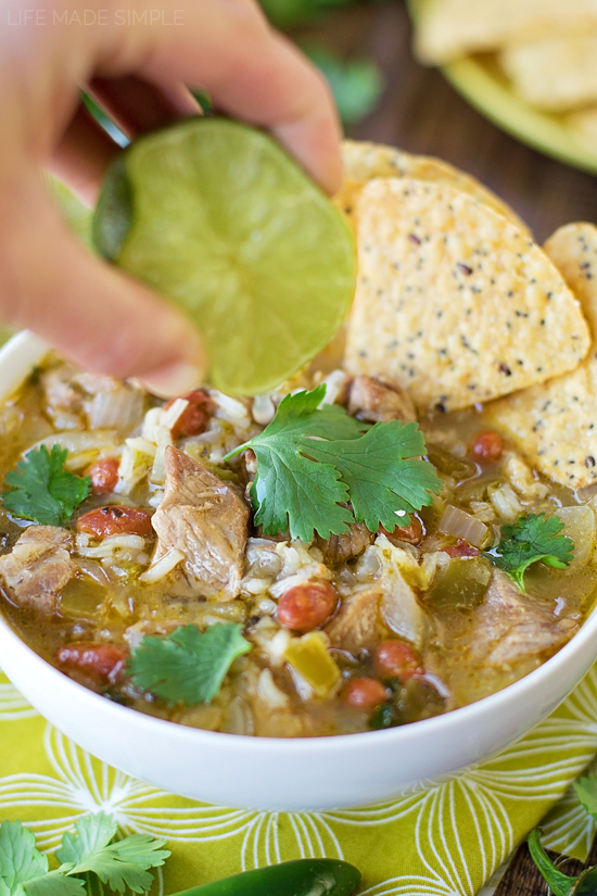 Squeezing lime juice into chile verde soup