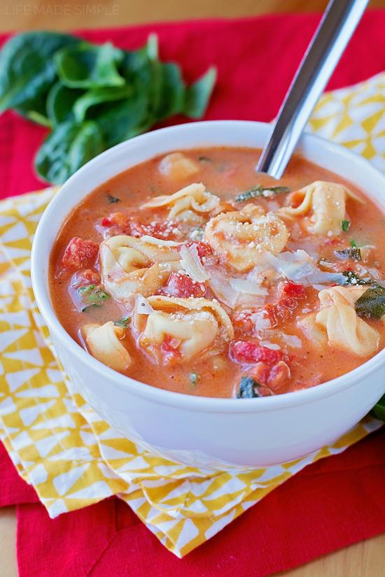 Tomato tortellini soup in a white bowl