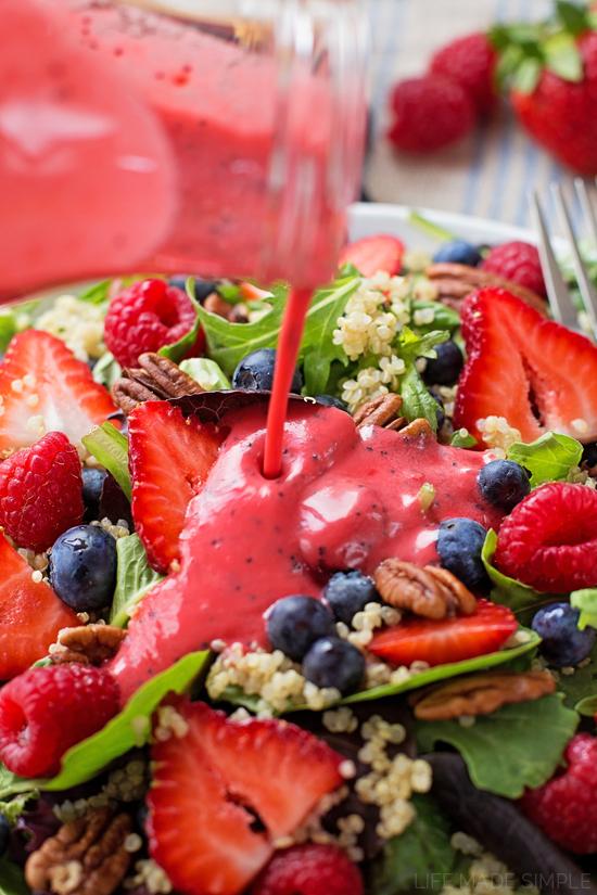 Pouring dressing over Berry Quinoa Salad