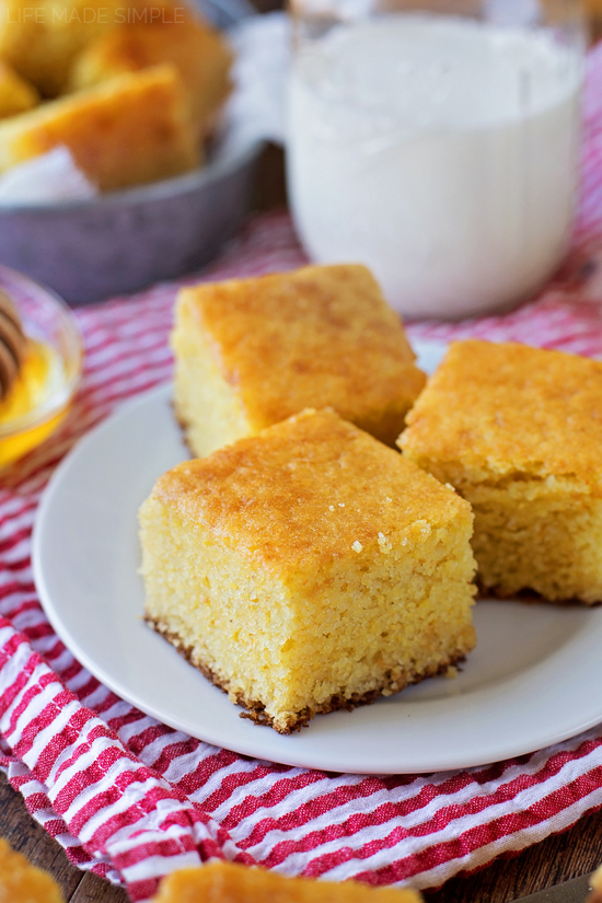 Buttermilk Cornbread cut up and on white plate