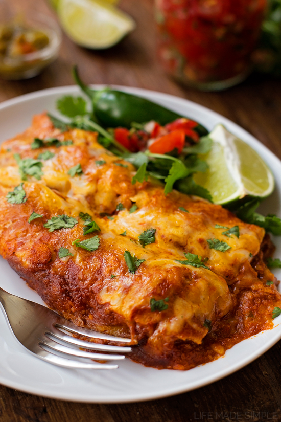 Beef Enchiladas on a white plate with a side salad