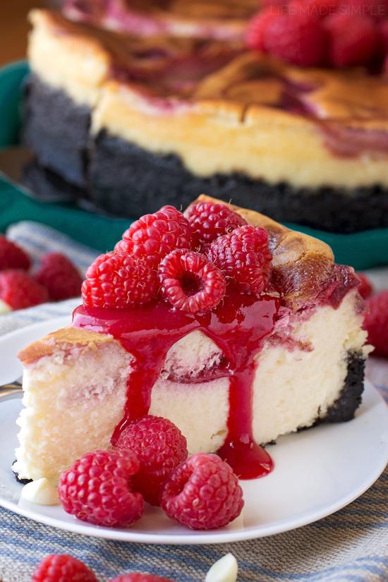 White Chocolate Raspberry Cheesecake on white plate