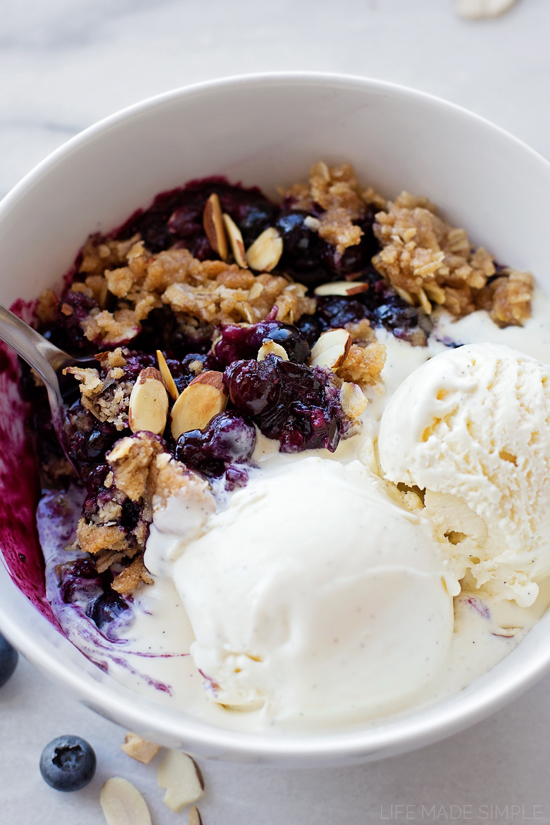 Healthy blueberry crisp with oat and almond topping