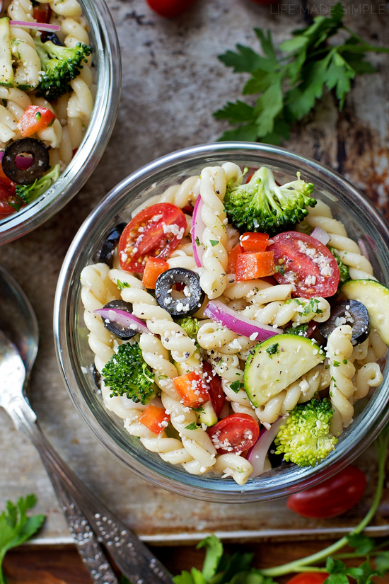 Summer vegetable pasta salad in a glass bowl