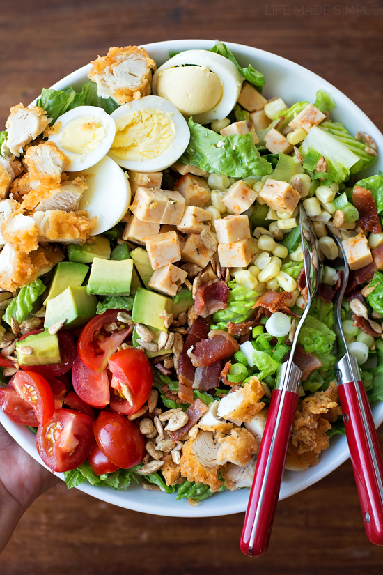 Cobb salad recipe in a bowl with a fork