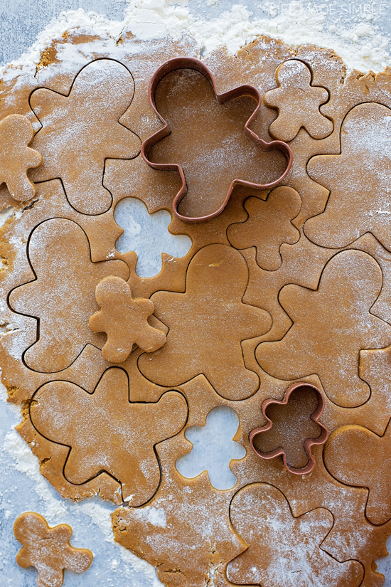 Gingerbread cookie dough rolled with cut outs