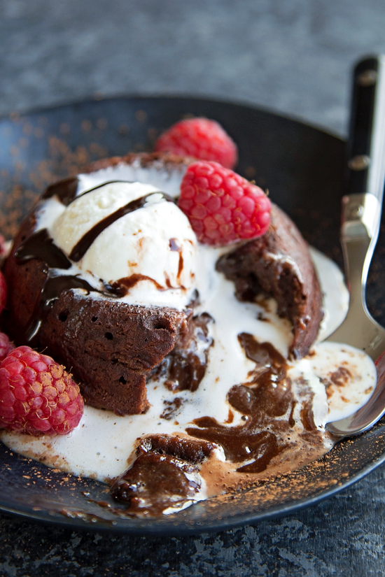 Chocolate Molten Lava Cake topped with vanilla ice cream and raspberries