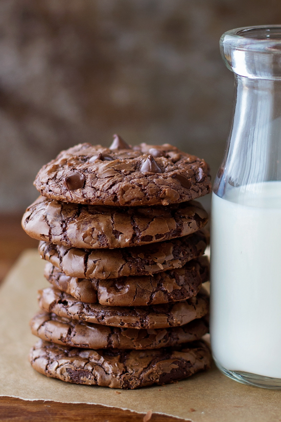 A stack of Brownie Cookies with a glass of milk