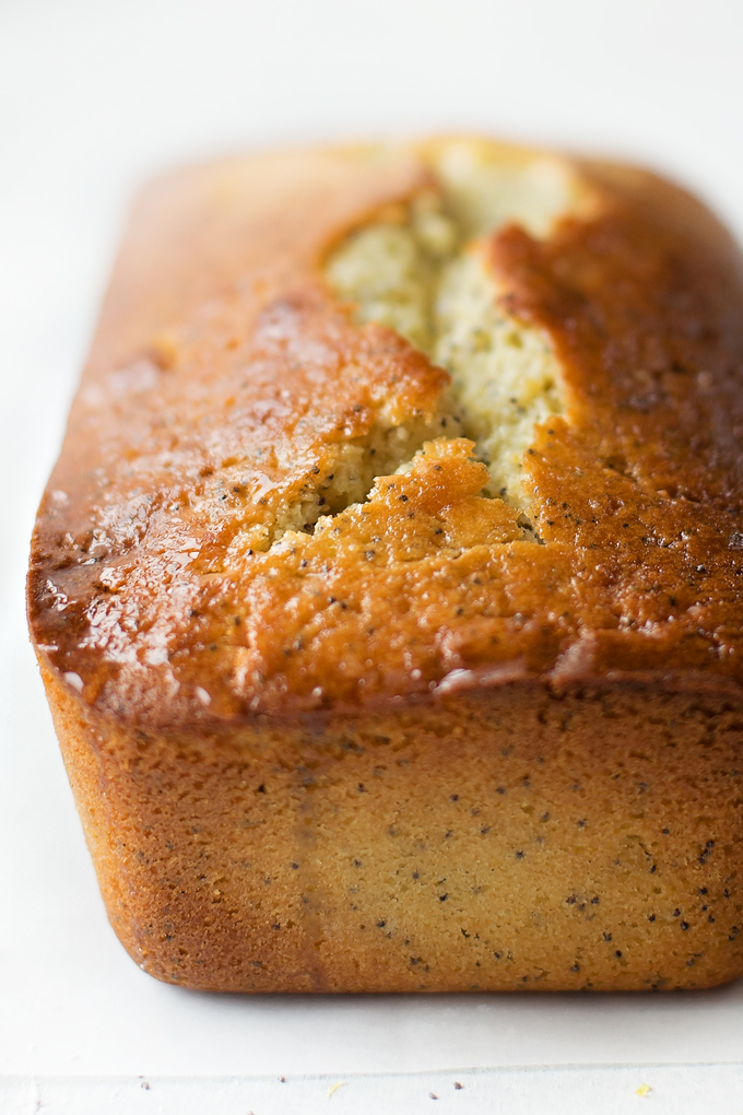 Close up of lemon poppy seed bread with glaze