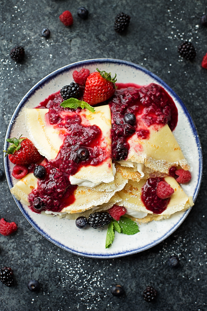 Fruit and cream crepes on a plate