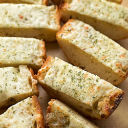 est Ever Cheesy Garlic Bread - Loaded with a buttery garlic sauce and LOTS of mozzarella and parmesan cheese!