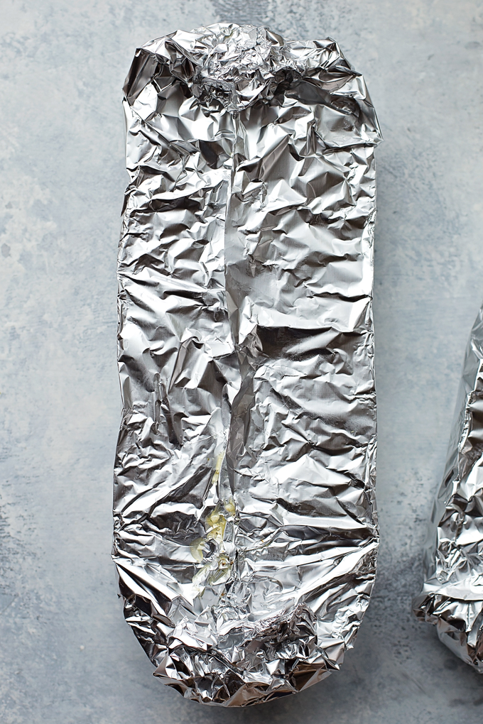 Homemade garlic bread wrapped in foil