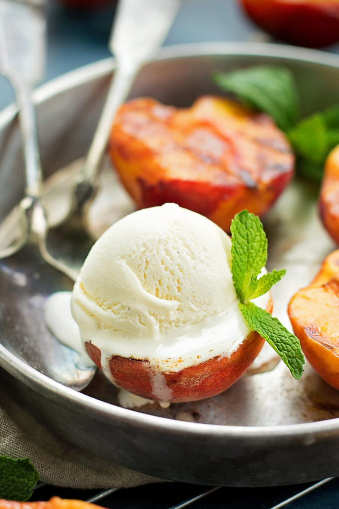 Grilled Peaches topped with vanilla ice cream