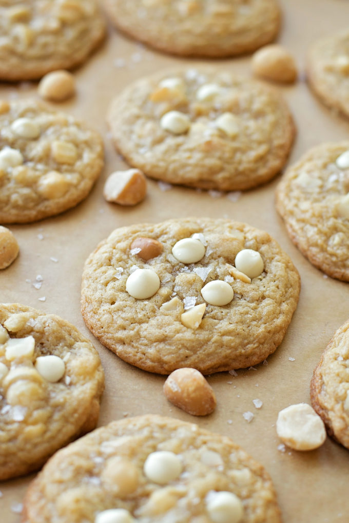 White Chocolate Macadamia Nut Cookies on parchment paper